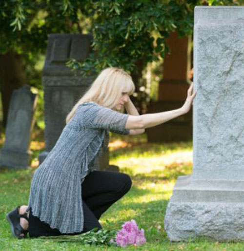girl standing at monumental grave