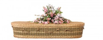 wicker casket with-flowers-for green funerals
